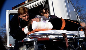 Man being loaded into ambulance on stretcher personal injury attorney baltimore maryalnd